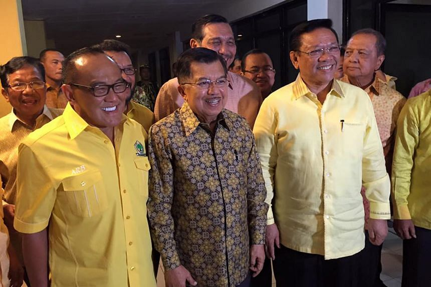 (From left) Mr Aburizal Bakrie, Vice-President Jusuf Kalla, coordinating minister Luhut Pandjaitan (partly hidden) and Mr Agung Laksono at the Golkar meeting on Sunday.