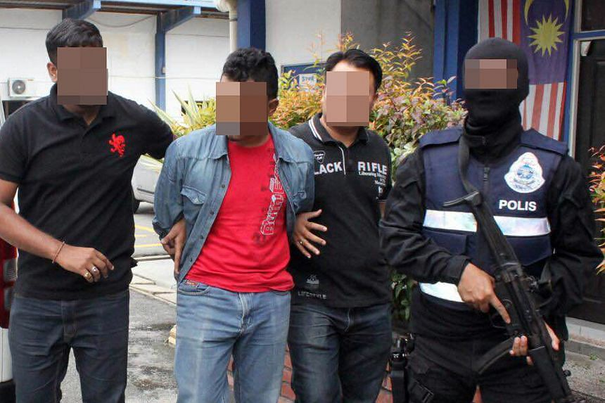 A suspect being arrested last Friday, during police swoops in Selangor, Perak and Johor.