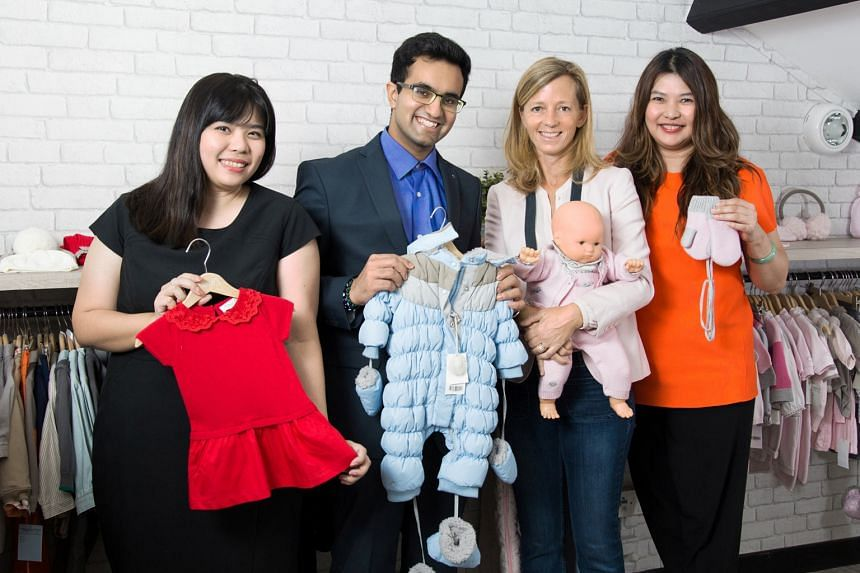 Children's clothing label Chateau de Sable will get some ideas to tackle its business challenges, thanks to an effort by DBS. Some of the people involved in the initiative are (from left): Ms Chloe Huang, programme manager, DBS BusinessClass; Mr Rajr
