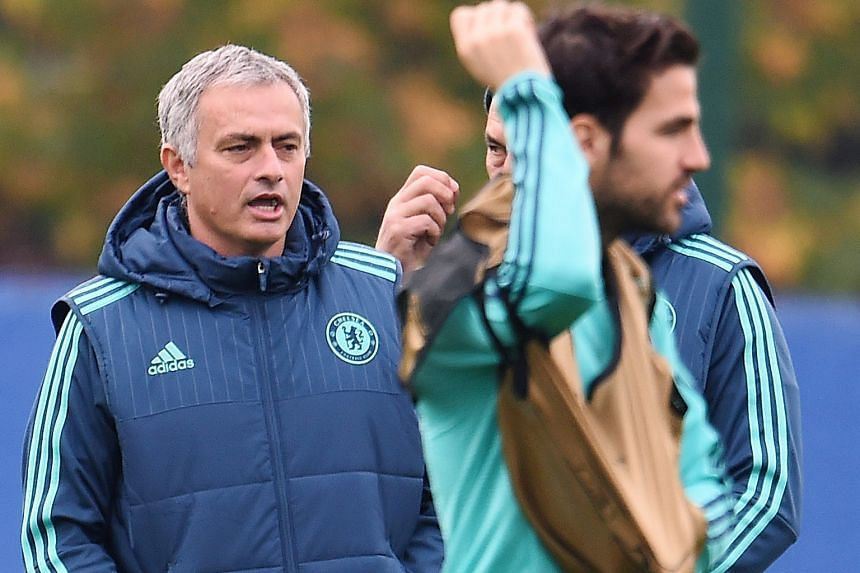 These are not happy days for Jose Mourinho (left), with Cesc Fabregas in training yesterday. He knows what is ailing Chelsea though he will not reveal details. But what is very apparent is that the Blues could be in danger of not making it to the kno