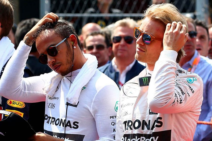 Lewis Hamilton (left), on the grid with Nico Rosberg before Sunday's Mexican Grand Prix. The world champion added to the bad blood between the pair, suggesting that he, instead of his Mercedes team-mate, would have won the race if he had not been ask