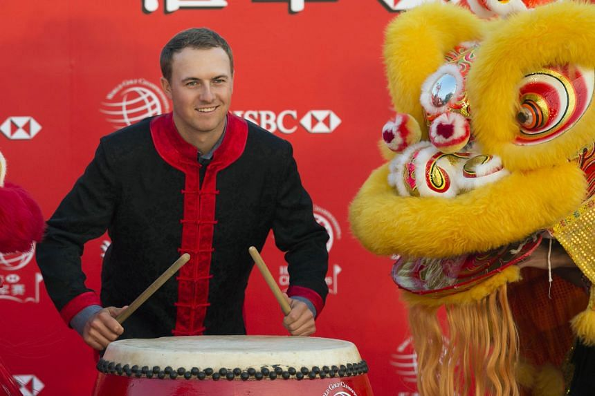 American golfer Jordan Spieth posing for a photo call in a traditional Chinese costume to kick off the WGC-HSBC Champions tournament in Shanghai yesterday.