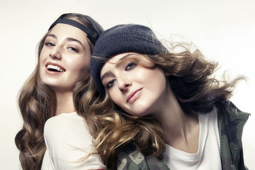 Nudestix founder Jenny Frankel's daughters Taylor (left) and Ally (far left) are the faces of the brand and help develop the make-up pencils (above).