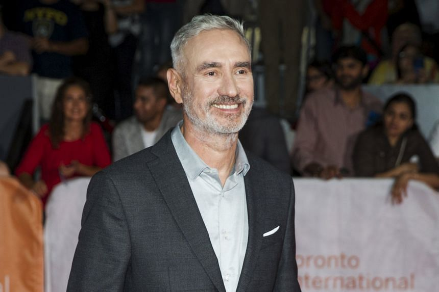 Director Roland Emmerich (left) at the Toronto Film Festival, where he was promoting his film, Stonewall, starring Jeremy Irvine (above).