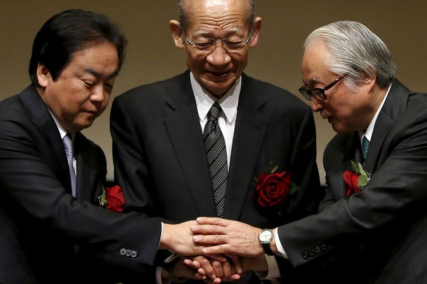 Japan Post Holdings president Taizo Nishimuro (centre), Japan Post Bank president Masatsugu Nagato (right) and Japan Post Insurance president Masami Ishii after a ceremony to mark the triple debut on the Tokyo Stock Exchange yesterday.