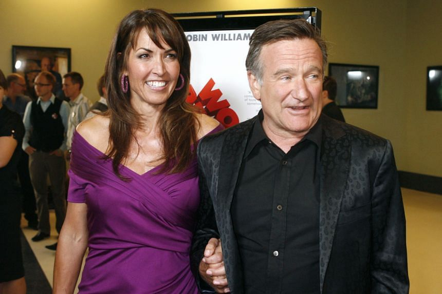 Susan Schneider Williams laid the blame for her husband (both left) Robin Williams' suicide last year on diffuse Lewy body dementia.