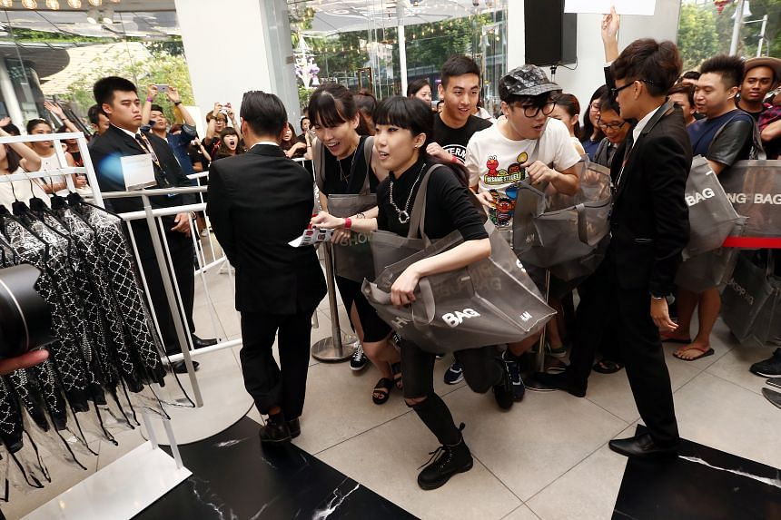 Freelance fashion designer Bi Yue (above) with her buys totalling more than $8,000. Customers were let into the Orchard Building store (above) at 8.02am.
