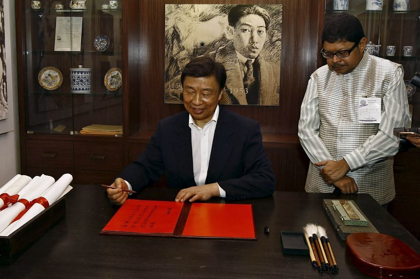 China's Vice-President Li Yuanchao after penning his entry in a visitor's book at the Chinese gallery of a museum during his visit to the ancestral house of Indian poet Rabindranath Tagore in Kolkata, India, yesterday. Mr Li is on a five-day official