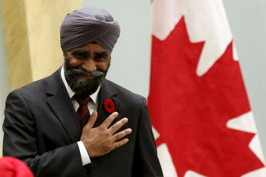 New Canadian Defence Minister Harjit Sajjan being sworn in at Rideau Hall in Ottawa, Canada on Wednesday. The former police officer, who has served three stints in Afghanistan, was born in India.