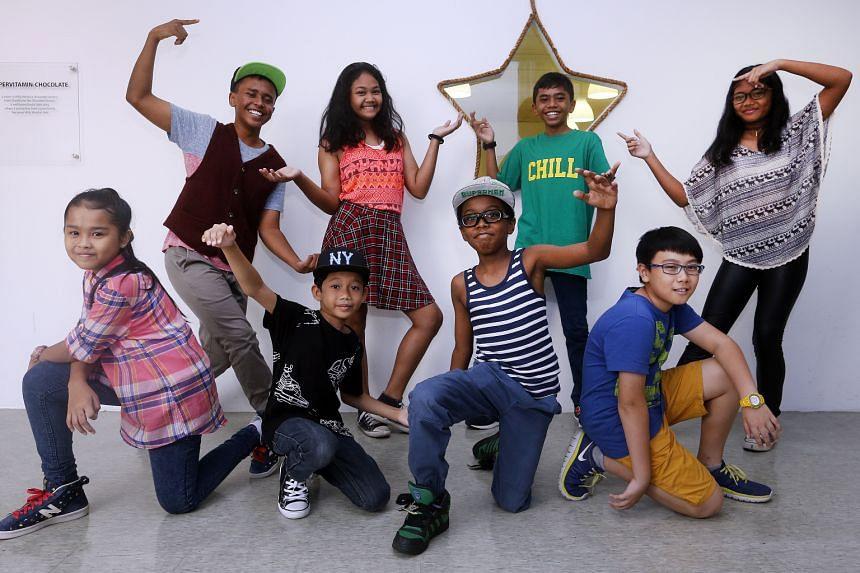 Some members of dance group Sugar Rush (clockwise from back row far left) Muhammad Shah Zainee Esham, 13, Sri Dhea Dhanira Riszuan, 10, Muhammad Shah Zamani Esham, 11, Sri Ayu Andhira Riszuan, 11, Macken Poon, 11, Obi Bonarr Chukwuma Junior, 10, Nur