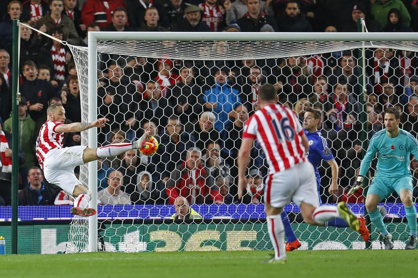 Stoke City's Marko Arnautovic scoring against Chelsea with a scissor kick in their Premier League encounter at Britannia Stadium on Saturday. The reigning champions are plagued by the fact that their forwards are unable to score while their defence h