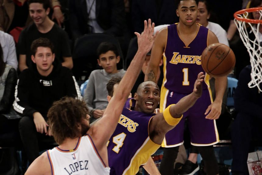 Los Angeles Lakers forward Kobe Bryant (centre) trying to shoot past New York Knicks centre Robin Lopez (No. 8) at Madison Square Garden on Sunday. The Knicks triumphed 99-95.