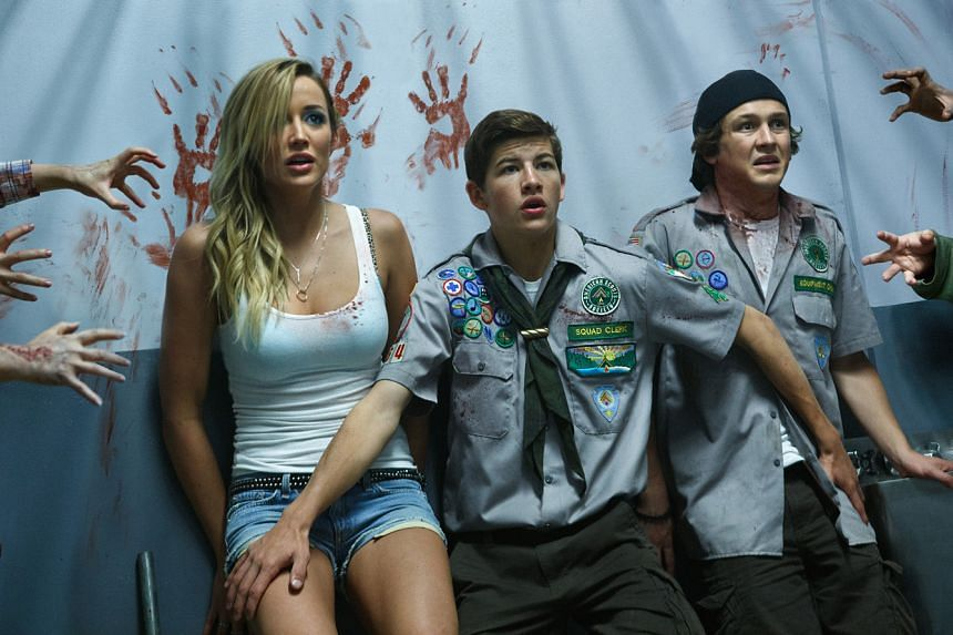 Two high school friends (Tye Sheridan, above centre; and Logan Miller, above right) and a strip-club waitress (Sarah Dumont, above left) find their way to safety in Scouts Guide To The Zombie Apocalypse.