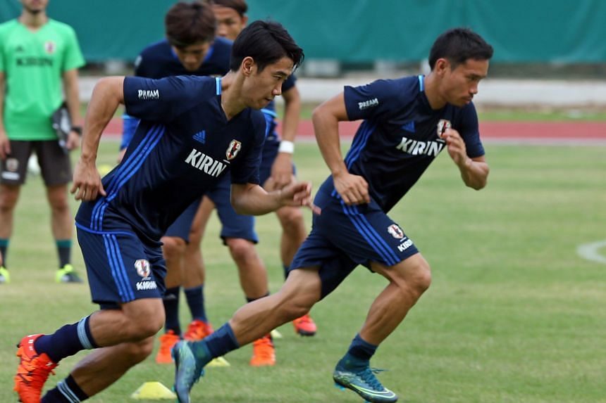 The experience of playing in Europe for the likes of Borussia Dortmund's Shinji Kagawa (far left, training at Bishan Stadium yesterday) is seen by team-mates as giving the Blue Samurai more bite against Singapore.