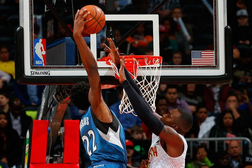 Andrew Wiggins of the Minnesota Timberwolves dunking over Paul Millsap of the Atlanta Hawks at Philips Arena. Guard Wiggins scored 33 points in Minnesota's 117-107 victory, their first in 13 games in Atlanta in nearly 13 years.