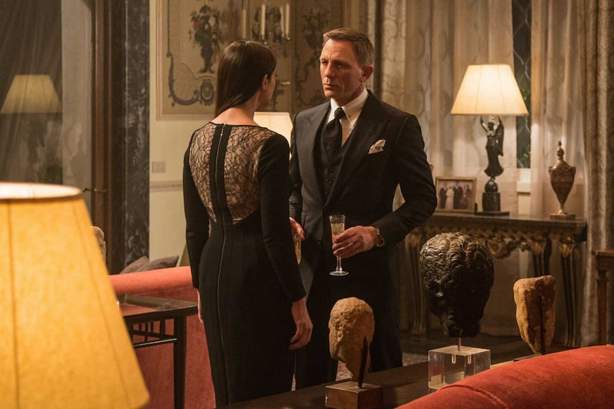 Actor Daniel Craig, who reprises his role as James Bond in Spectre, in a Tom Ford suit (above). Actress Lea Seydoux in a bespoke dress in Spectre (right).