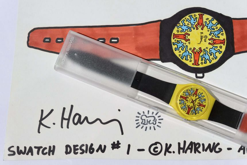 Swatches designed by Kiki Picasso (above) and Keith Haring (left) were part of the collection that was auctioned on Tuesday.