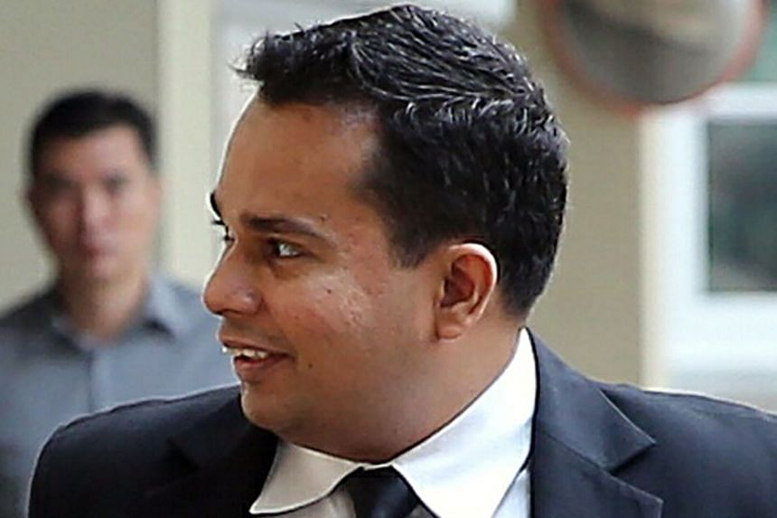 Kovan double murder suspect, Iskandar Rahmat (top), being taken to court in a 2013 photo. He disagreed with Deputy Public Prosecutor Prem Raj Prabakaran (above), insisting that he had wanted to simply grab the money and flee from the house.