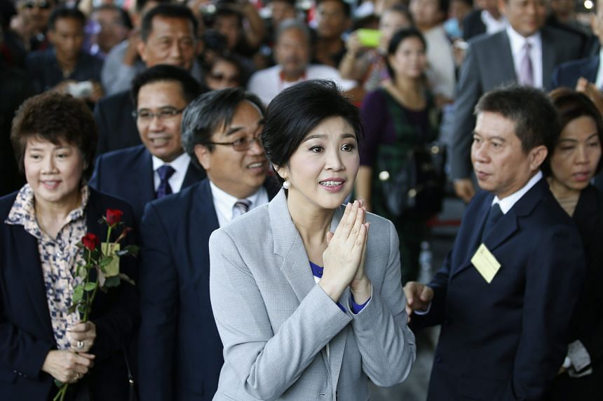 Former Thai prime minister Yingluck Shinawatra offering a traditional greeting on arrival in court last month to face criminal charges stemming from her government's rice subsidy scheme.