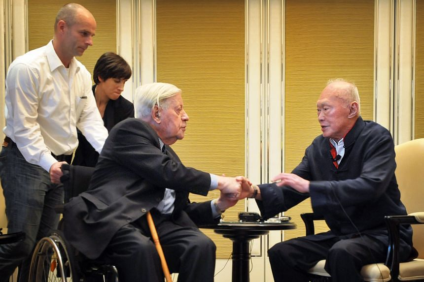 Former German chancellor Helmut Schmidt (left) and founding Prime Minister Lee Kuan Yew having a warm exchange at the end of a press conference at the Shangri-La hotel in 2012. The two close friends spent three days discussing world politics during M