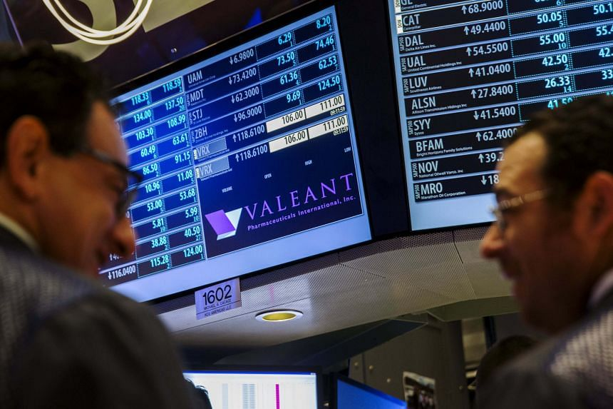 Traders on the floor of the New York Stock Exchange where crisis-stricken Canadian drug maker Valeant Pharmaceuticals lost 55 per cent of its share value in the past four weeks, after it was accused by short-seller Citron Research of using speciality