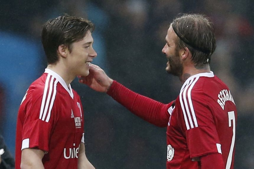 Beckham replaces Beckham - David is replaced by his son Brooklyn, 16, while playing for a combined Britain-Ireland side that defeated a Rest of the World team 3-1 in a Unicef charity match at Old Trafford on Saturday.
