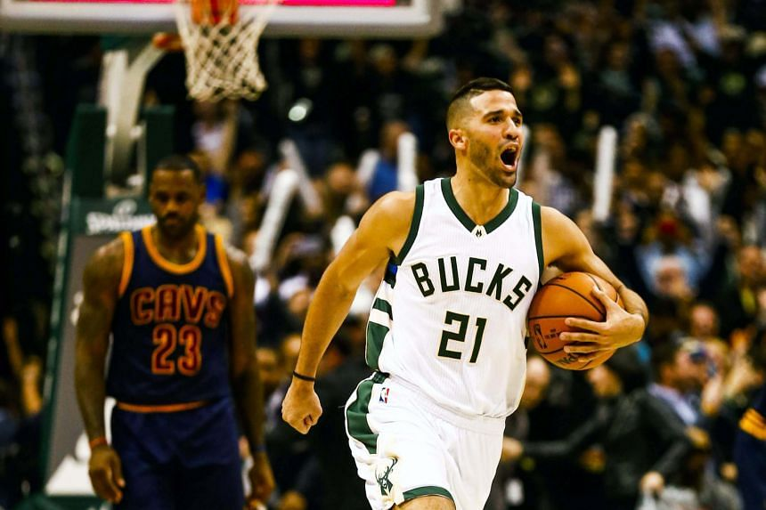 Milwaukee guard Greivis Vasquez of Venezuela whooping for joy as the final buzzer goes and the backboard lights up, while a despondent Cleveland forward LeBron James walks off the court. The Bucks won 108-105 in double overtime.