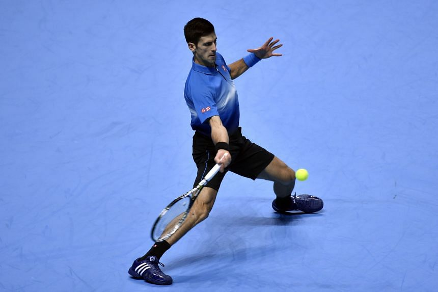 "World No. 1 Novak Djokovic in action during his 6-1, 6-1 rout of Kei Nishikori in the ATP World Tour Finals. ""It's the best season, best year of my life,"" said the Serb, who has dominated the 2015 season with 79 victories."