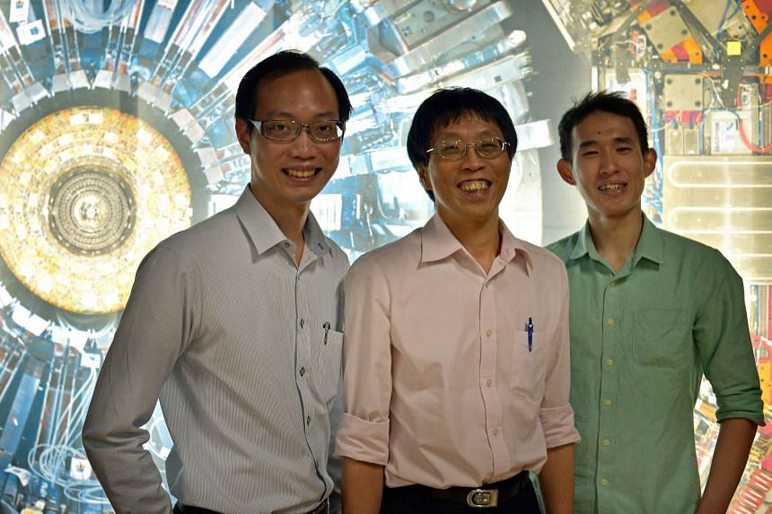 Mr Leong Qixiang (left) and Mr Tan Hong Qi (right) have spent time at the Collider as part of a Cern programme, which is coordinated here by associate professor Phil Chan (centre).