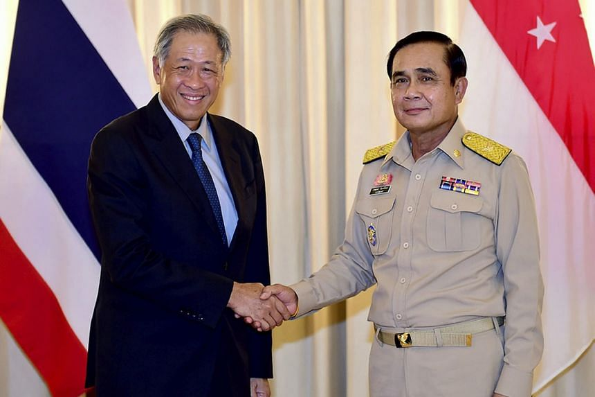 Singapore's Defence Minister Ng Eng Hen with Thai Prime Minister Prayut Chan-o-cha at Government House in Bangkok yesterday.