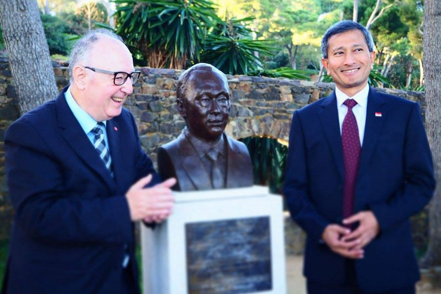 Singapore's honorary consul-general in Barcelona, Dr Josep Manuel Basanez, and Foreign Minister Vivian Balakrishnan with the bust of the late Mr Lee Kuan Yew in Barcelona.