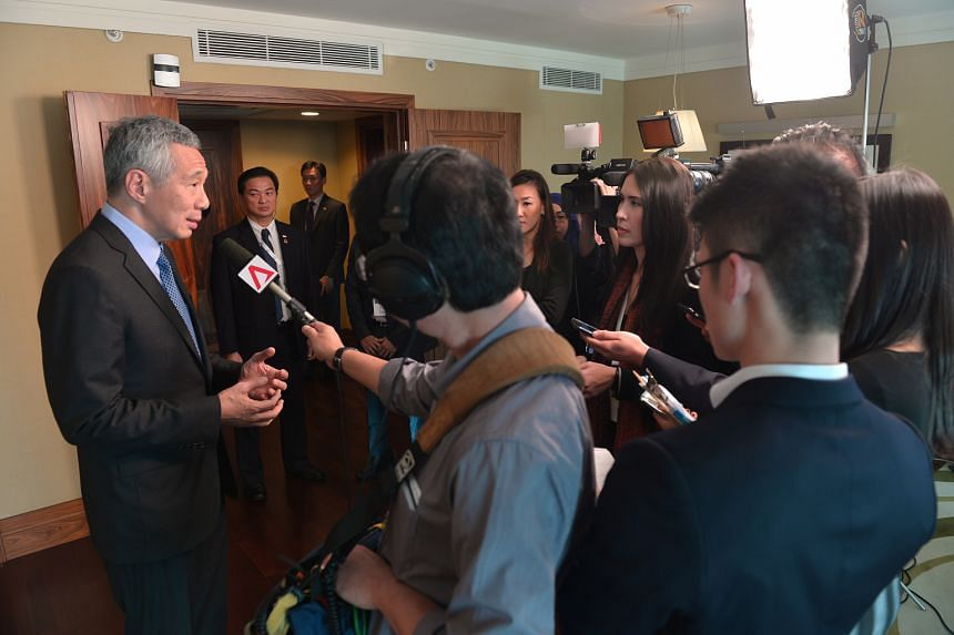 PM Lee speaking to Singapore journalists yesterday in his hotel suite at the conclusion of the G-20 Summit in Antalya, Turkey.