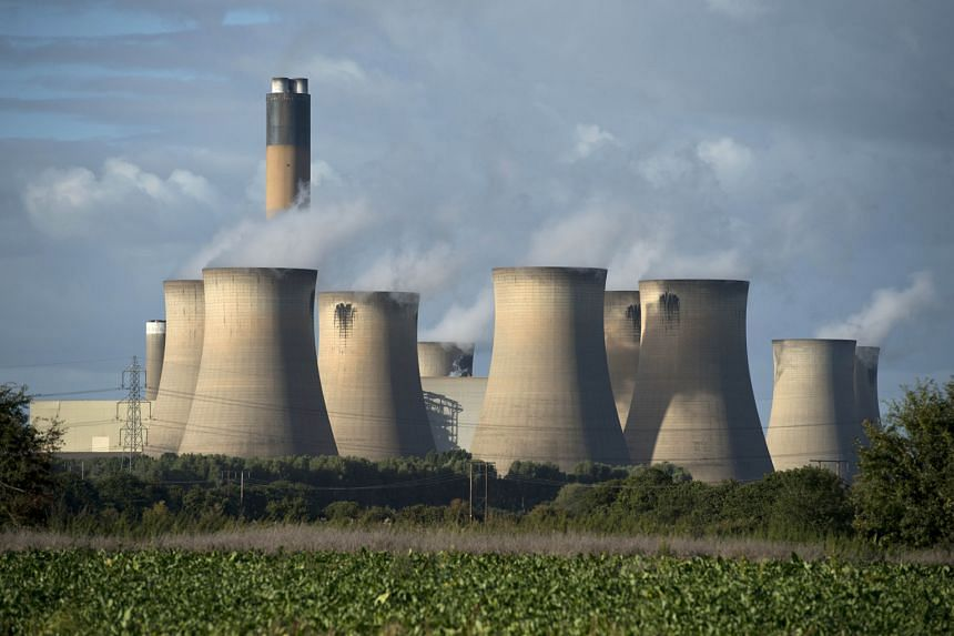The cooling towers of a coal-fired power station near Selby, northern England. The United Kingdom plans to wind down coal-fired power plants, with plans to replace them with gas and nuclear stations.