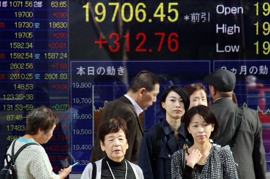 [ ]The Fed minutes brought relief to emerging markets investors and a fillip to Asian bourses. Tokyo (above) gained 1.07 per cent to reach its highest closing level in three months.