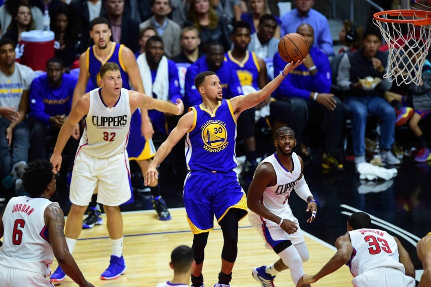 Stephen Curry (No. 30) scores for the Golden State Warriors against the Los Angeles Clippers on Thursday. He scored 40 points in the 124-117 victory after the Warriors trailed by 23 points in the first half and said their 13th consecutive win was a ""