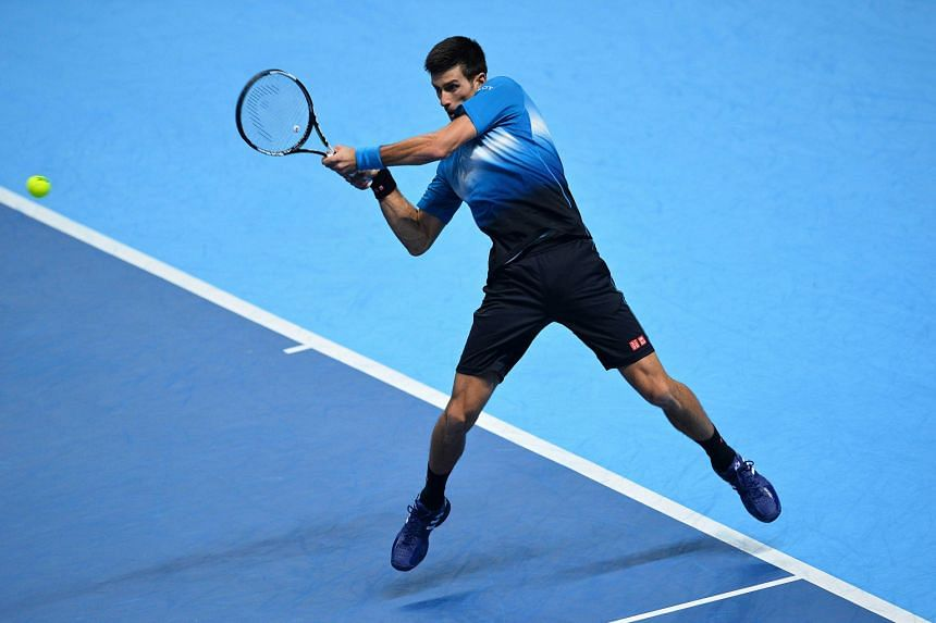 Novak Djokovic returning against Tomas Berdych during his 6-3, 7-5 win against the Czech during the ATP World Tour Finals in London on Thursday. The Serb is aiming for a record fourth consecutive title.