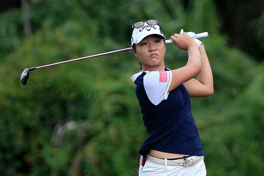 Kiwi teen Lydia Ko driving the ball on the sixth hole, where she had the first of four birdies. South Korean Park In Bee is chasing her down for the year-end top ranking.