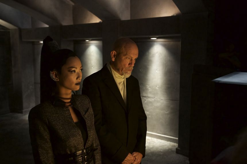 John Malkovich and Chang Shuya (both left) in a clip of the film. It is a project for Remy Martin's Louis XIII cognac, which takes 100 years to make.