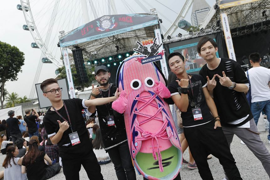 Korean hip-hop trio Epik High drew the biggest crowd of the night at Skechers Sundown Festival and Taiwanese indie-group Ground Zero (above) posed with the Skechers mascot.