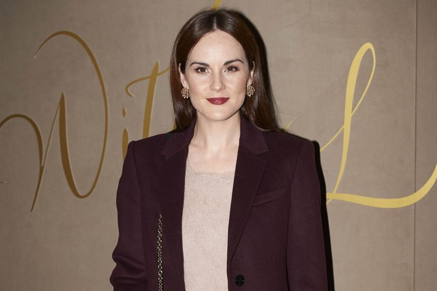 Actress Michelle Dockery says her stint on television series Downton Abbey gave her a chance to learn more about fashion.