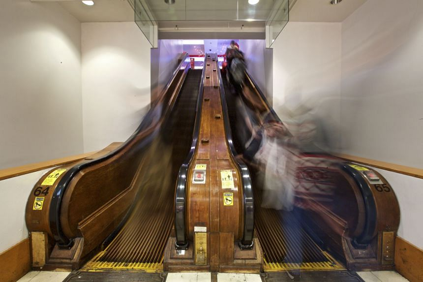 A wooden escalator at the mall after the renovation.