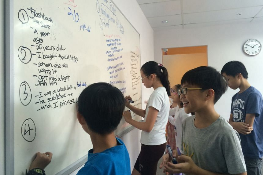 Upper-primary pupils planning their essays at the Study Room. This year, some students made trips to tuition centre co-founder Lim Wei Yi's alma mater, Hwa Chong Institution - aimed at motivating them to study hard - and to a radio station to see how