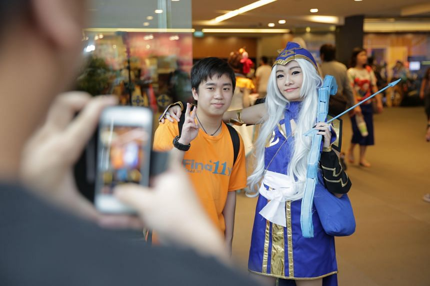 Cosplayers (above) taking a selfie. Mr James Ng (left), a contestant at the regional cosplay competition, spent $500 making his costume for Saint Seiya, and student Eileen Chee (below) dressed as Ashe from online game League Of Legends. Polytechnic s