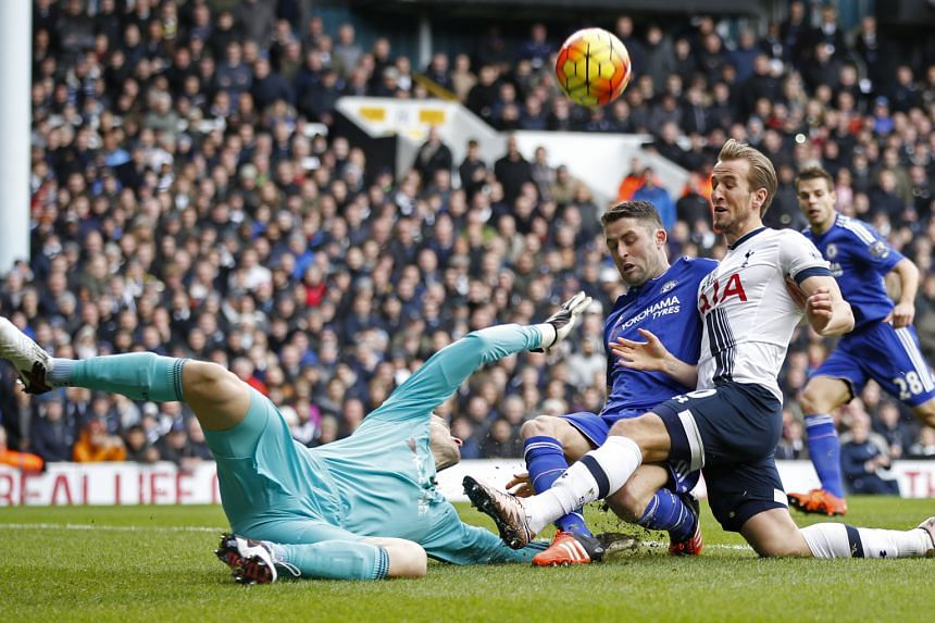 Chelsea 'keeper Asmir Begovic was hurt in this collision with Gary Cahill and Spurs' Harry Kane. But he was able to continue after treatment.
