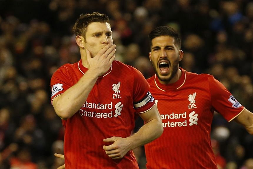 Liverpool captain James Milner celebrating with Emre Can after scoring from the penalty spot. That was the only goal in the game, which took the Reds to sixth place on the Premier League table.