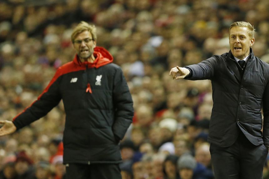 Liverpool manager Juergen Klopp (left) can take credit for presiding over their revival, even if performances have not improved significantly. But one win in 10 league games is the kind of run which inevitably increases pressure on Swansea manager Gerry M