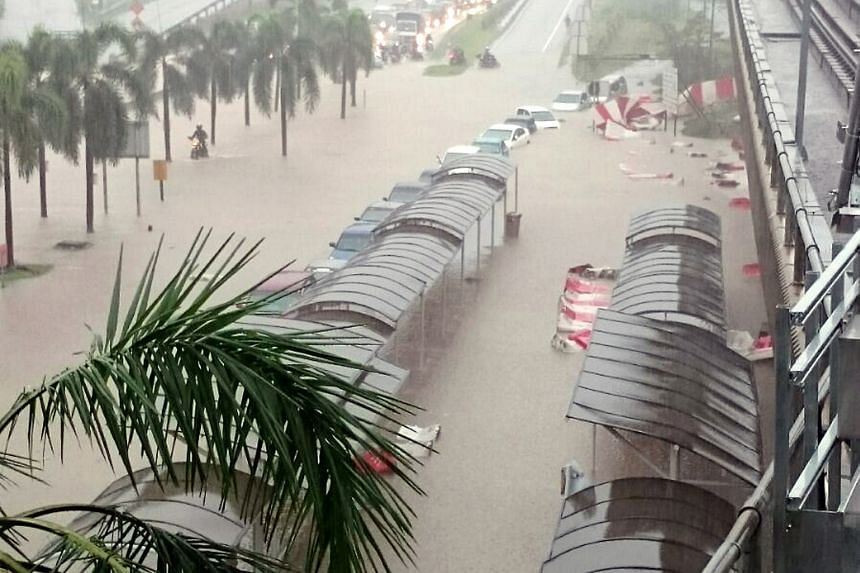 The Sungai Besi LRT station in Kuala Lumpur surrounded by flood waters on Monday. Yesterday, six Malaysian states issued alerts after water levels reached worrying levels, reported The Star newspaper. The Drainage and Irrigation Department's website,