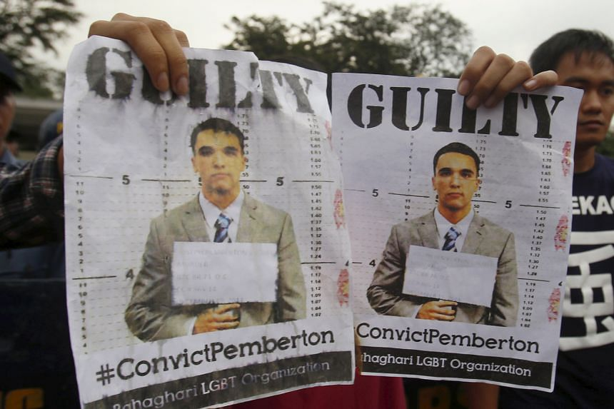 Activists in Manila with posters of US Marine Lance Corporal Joseph Scott Pemberton, who was found guilty of homicide yesterday in the killing of Filipino transgender person Jeffrey Laude last year.