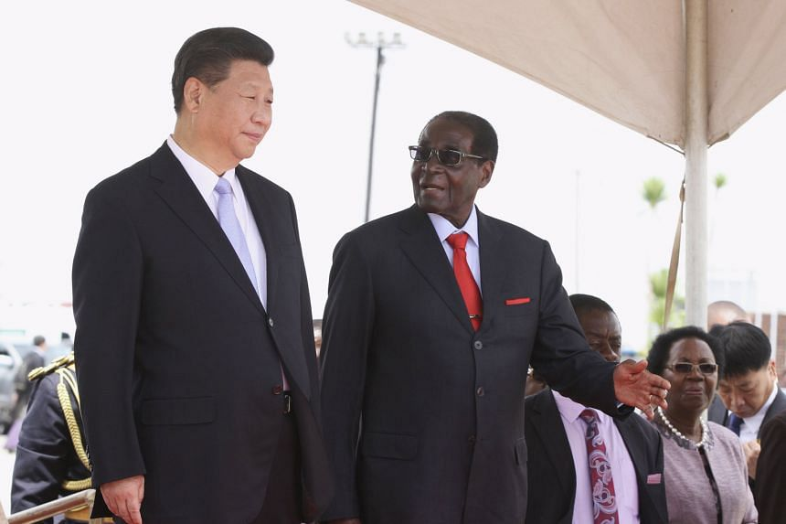 Chinese President Xi Jinping being welcomed to Zimbabwe by President Robert Mugabe yesterday. Mr Xi is expected to use his five-day visit to Africa to showcase China's expanding role as a protector of regional security, a revision of the country's ha