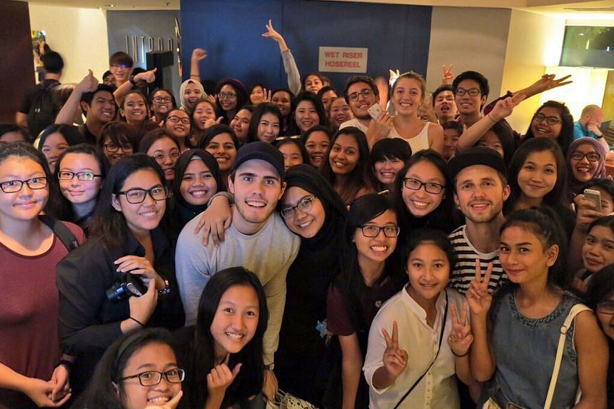 YouTubers Alfie Deyes and Marcus Butler; and with their fans at the Swissotel The Stamford hotel (above).
